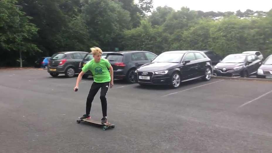 Jake on his Motorised Skateboard